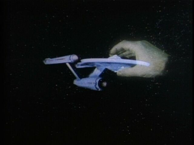 File:Apollo's hand grips the Enterprise.jpg